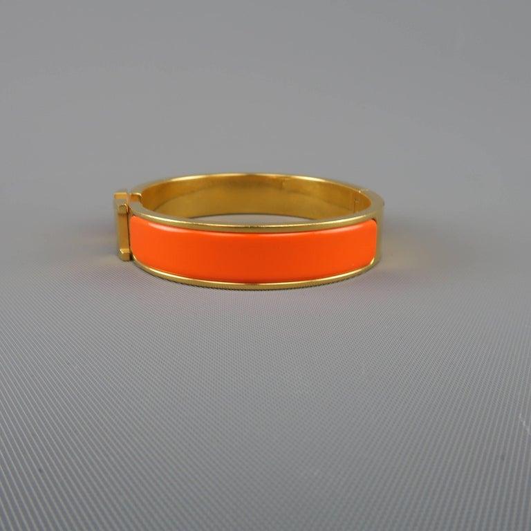 hermes 18k gold plated orange enamel clic h bangle