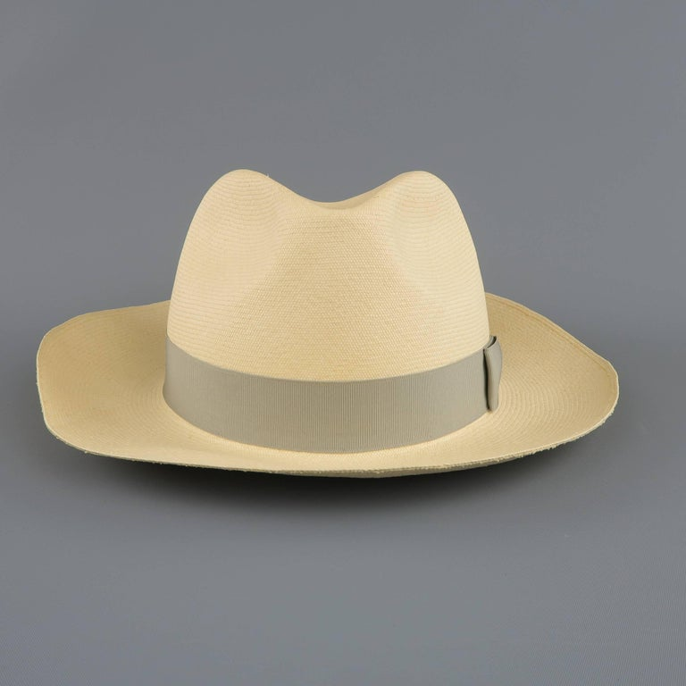 GRAHAM THOMPSON for WILKES BASHFORD Panama hat comes in natural beige straw with a thick, silver gray grosgrain ribbon.   Excellent Pre-Owned Condition. Marked: 59   Brim: 2.5 in.   SKU: 85259