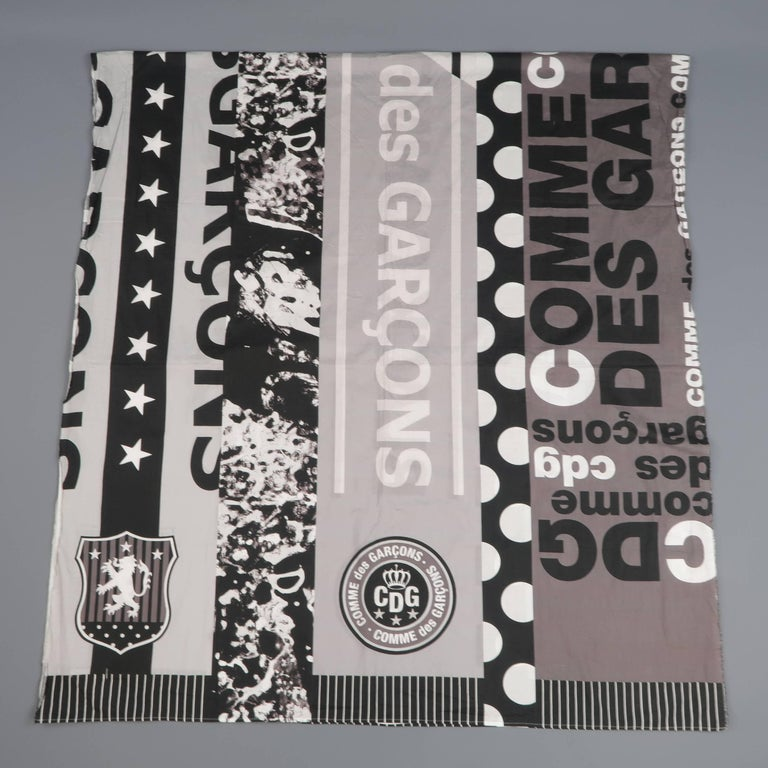 Oversized COMME des GARCONS blanket scarf comes in a light weight cotton with abstract logo stripe graphic print and frayed edges. Made in Japan.   Good Pre-Owned Condition.   92.5 x 44 in.  SKU: 67427