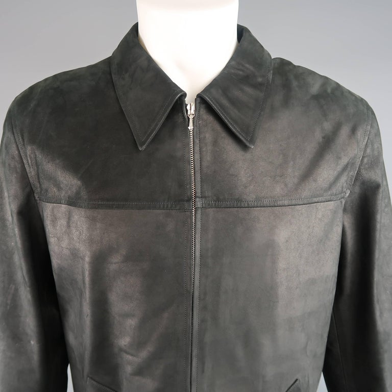 Classic AGNES B. HOMME car coat comes in a smooth semi matte textured leather with a pointed collar, silver tone double zip front, and slanted pockets. With tags. Made in France.   Good Pre-Owned Condition. Retails: $1,200.00. Marked: EU 50