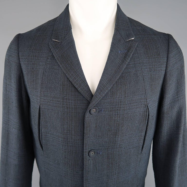 THE VIRDI-ANNE sport coat comes in a navy and black plaid silk linen blend canvas and features a small peak lapel, four button closure, four slit pocket front, and folded cuffs. Wear throughout Fabric. Made in Japan.   Good Pre-Owned