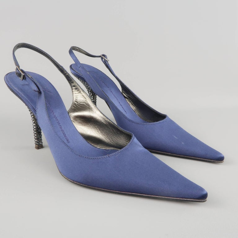 GIUSEPPE ZANOTTI slingback evening pumps come in navy blue silk satin covered leather and feature a pointed toe, and rhinestone studded stiletto heel. Made in Italy.   Good Pre-Owned Condition. Marked: 10 B   Heel: 4 in.  SKU: 87047