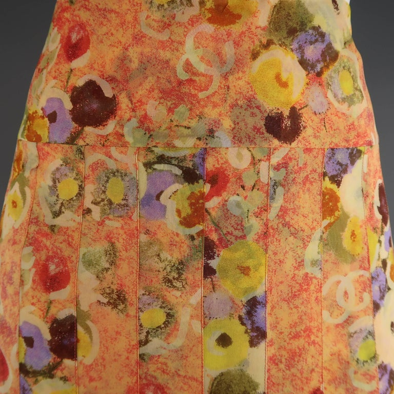Chanel  Spring 2004 A-line skirt comes in a gorgeous orange silk chiffon with multi-color floral print and features a pleated body with flared pleat drop waist hem. Made in France.   Excellent Pre-Owned Condition. Marked: FR 42 (04P)