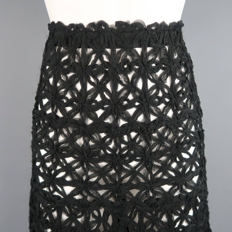 This gorgeous DONNA KARAN maxi skirt comes in a beautiful black floral pattern woven crochet mesh made of gathered black silk chiffon with a long A line silhouette. Made in Italy.   Excellent Pre-Owned Condition. Marked: 6   Measurements:   Waist: