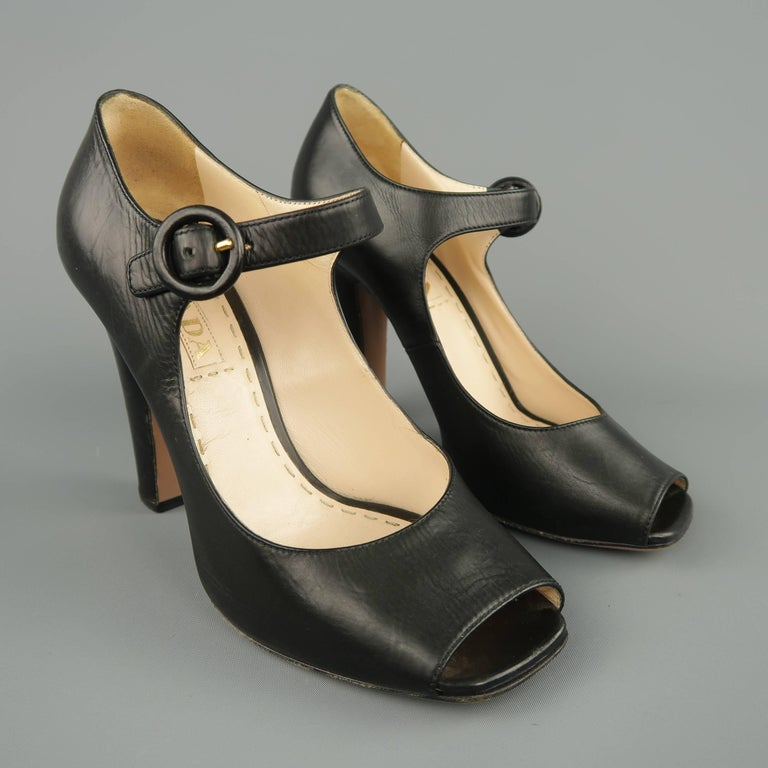 150e1231c2a PRADA pumps come in smooth black leather and feature a square peep toe
