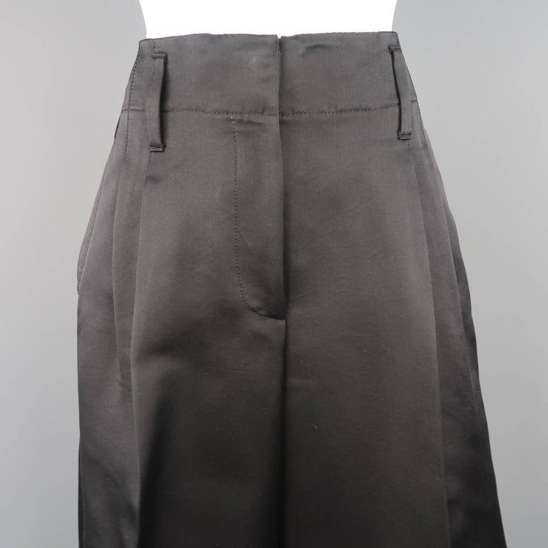 MARC JACOBS culottes come in black silk satin with a double pleat, wide leg, and cuffed hem. Made in USA.   Excellent Pre-Owned Condition. Marked: 6   Measurements:   Waist: 30 in. Rise: 13 in. Inseam:  23 in. Leg Opening: 31 in.