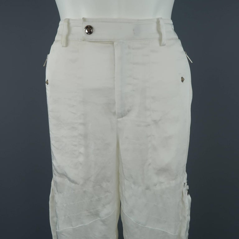 RALPH LAUREN BLACK LABEL pants come in a semi sheer satin with slanted zip pockets, patch cargo pocket sides, and motorcycle details. Wear throughout. As-is.   Fair Pre-Owned Condition. Marked: 8   Measurements:   Waist: 31 in. Rise: 9.5 in. Inseam: