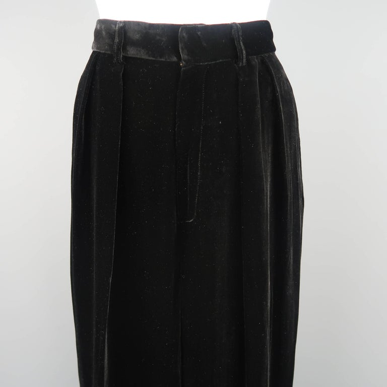 Vintage DONNA KARAN dress pants come in black silk blend velvet with a high rise, double pleats, and cuffed hem.   Excellent Pre-Owned Condition. Marked: 8   Measurements:   Waist: 27 in. Rise: 13 in. Inseam: 31 in.