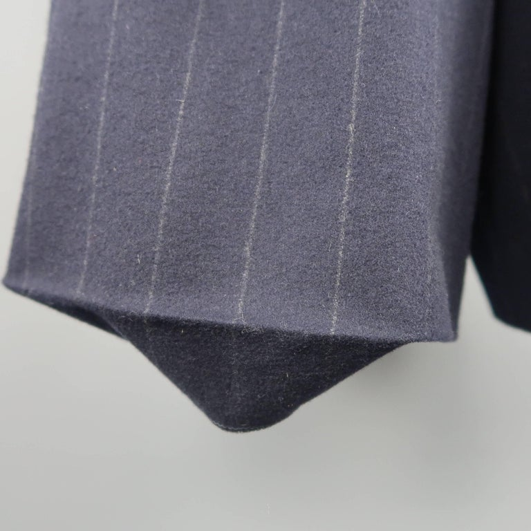 RALPH LAUREN COLLECTION shorts come in navy blue chalk stripe wool with a high rise, wide leg, and pleated front. Hem coming undone. As-is. Made in USA.   Good Pre-Owned Condition. Marked:   Measurements:   Waist: 26 in. Rise: 14 in. Inseam: 10.5
