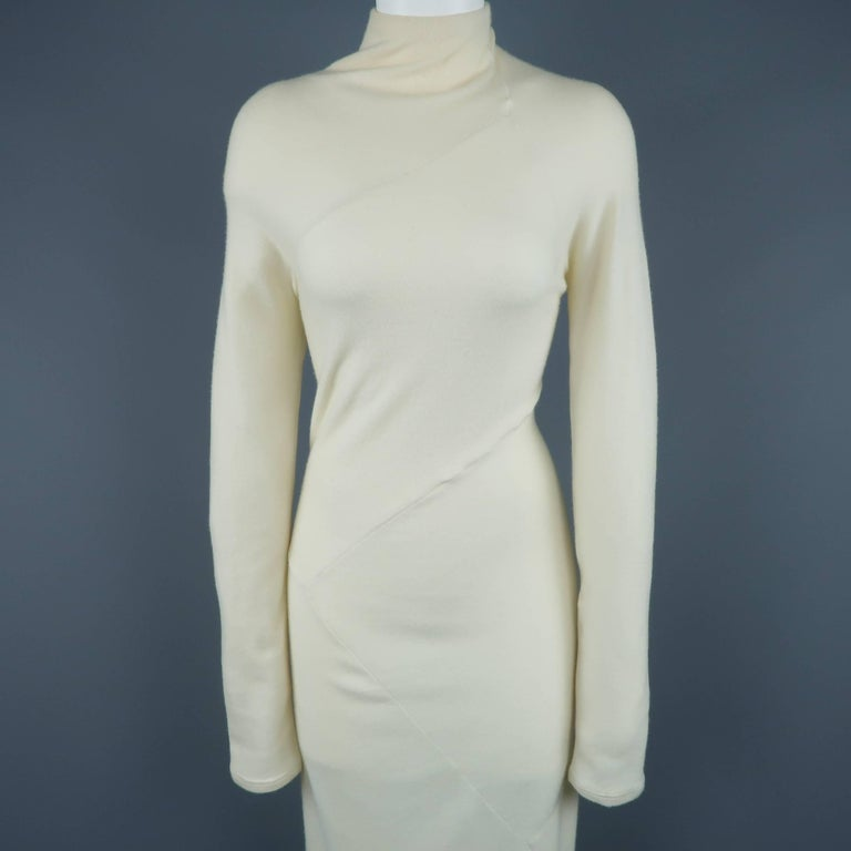 DONNA KARAN sweater midi dress comes in creamy beige stretch cashmere with a mock neck long sleeves and diagonal patchwork seam construction. Made in Italy.   Good Pre-Owned Condition. Marked: (no size)   Measurements:   Shoulder: 15 in. Bust: 35