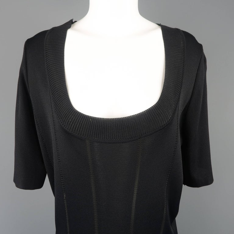 Vintage Claude Montana sweater mini dress comes in black knit with sheer stripes, a deep scoop neck, short sleeves, and thick fringe hem. Made in Italy.   Excellent Pre-Owned Condition. Marked:  42   Measurements:   Shoulder: 16 in. Bust: 44