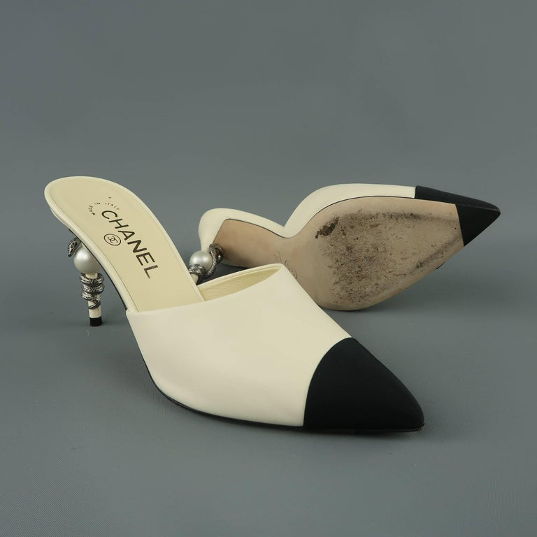 b68d173e CHANEL Size 8.5 Cream Leather & Black Grosgrain Toe Cap Snake Heel Mules