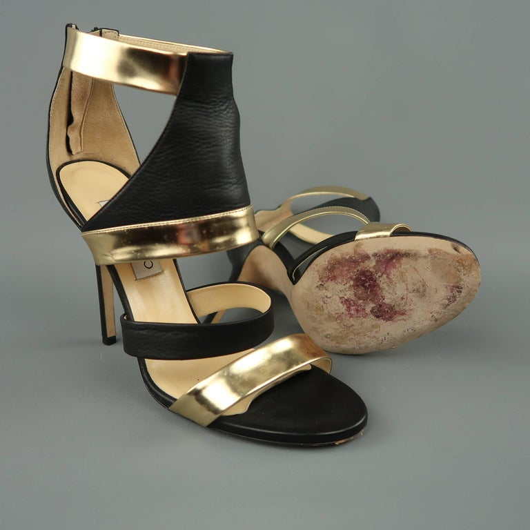 652e1bd1defc JIMMY CHOO. JIMMY CHOO Size 9 Black   Gold Leather BESSO Sandals In Good  Condition For Sale In