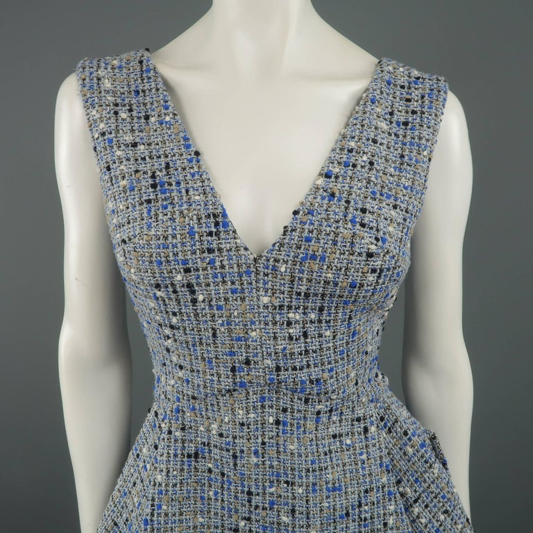 Christian Dior Resort 2016 cocktail dress comes in light blue wool blend tweed with hues of beige and black and features a V neckline, pleated flair A line skirt, and double back pockets. Made in France.   Excellent Pre-Owned Condition. Marked: 6