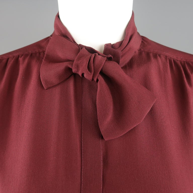 BURBERRY PRORSUM blouse comes in burgundy red silk crepe with a hidden placket front and bow collar. Stain on back. As-is. Made in Italy.   Fair Pre-Owned Condition. Marked: IT 42   Measurements:   Shoulder: 15 in. Bust: 42 in. Sleeve: 25