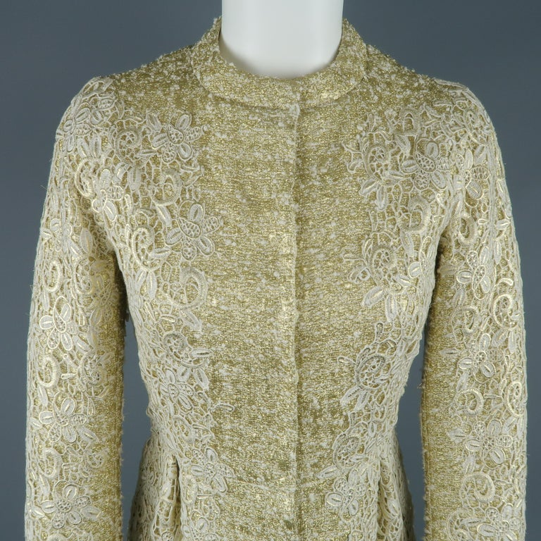 GIAMBATTISTA VALLI cocktail dress comes in a thick metallic gold tweed with a crew neck, hidden placket snap closure front, pleated pencil skirt, long sleeves, and overall cream lace overlay. Made in Italy.   Excellent Pre-Owned Condition. Marked: