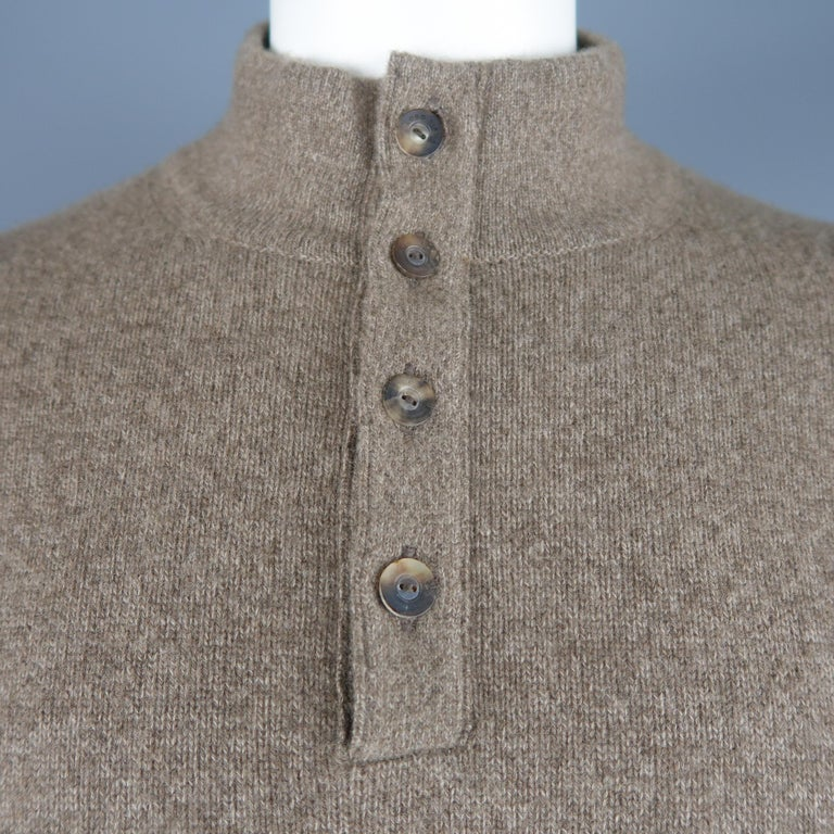LORO PIANA pullover comes in light taupe brown cashmere with a suede lined, half button mock neck collar. Made in Italy.   Excellent Pre-Owned Condition. Marked: IT 52   Measurements:   Shoulder: 21 in. Chest: 48 in. Sleeve: 25 in. Length: 27 in.