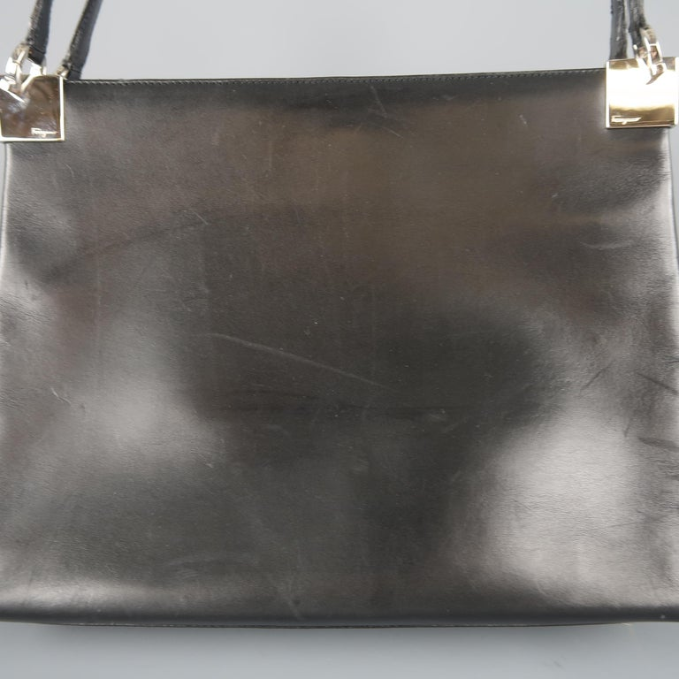 Vintage SALVATORE FERRAGAMO shoulder bag comes in smooth black leather with  a double compartment interior, b4355107f3
