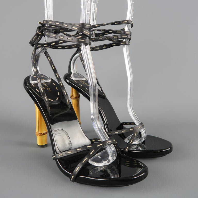 f5c16039c2b2 These fabulous GUCCI sandals feature thin black leather wrapped straps with contrast  stitching and a thick