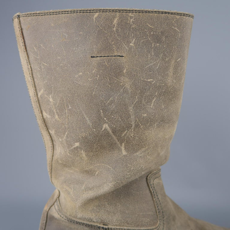 Prada tall pull on boots come in distressed beige suede with a rounded toe, internal pull on tabs, and thick rubber grip sole.   Good Pre-Owned Condition. Marked: UK 9   Measurements:   Length: 11.5 in.