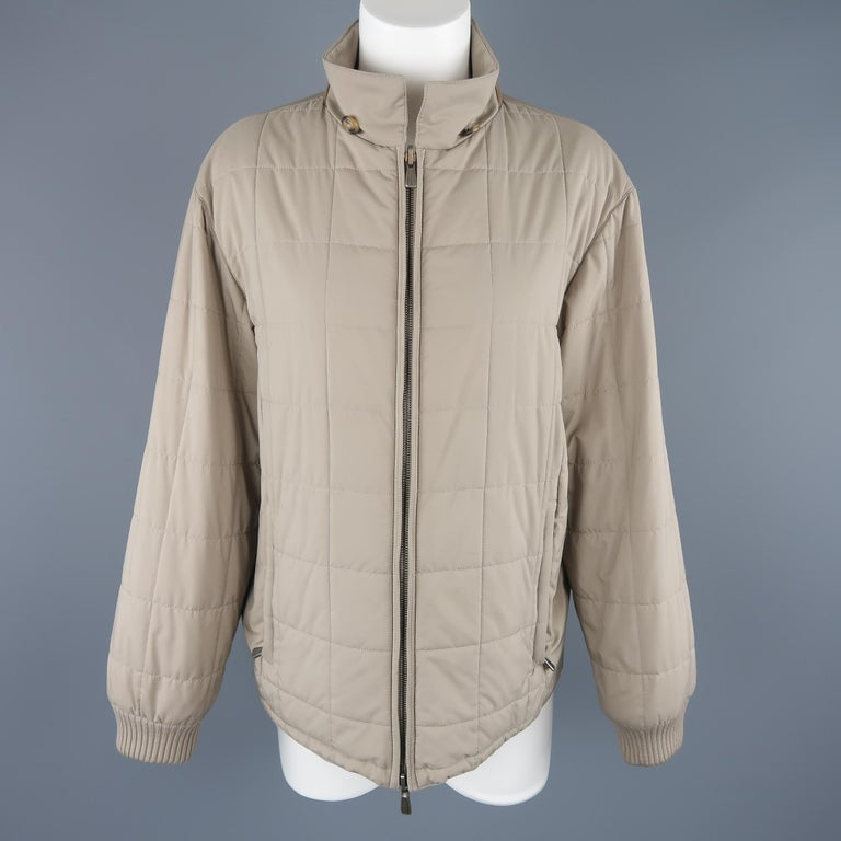 Loro Piana jacket comes in khaki beige quilted fabric with a pointed collar, double zip closure, and ribbed knit cuffs. Wear. As-is. Made in Italy.   Good Pre-Owned Condition. Marked: L   Measurements:   Shoulder:19 in. Bust: 42 in. Sleeve: 23