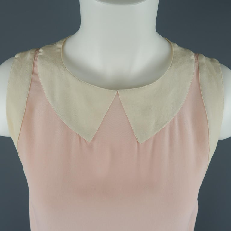Vintage sleeveless Chanel blouse comes in pink silk crepe chiffon with a color block mock collar and gold tone button back closure. Discolorations throughout. As-is.  Pre-Owned Condition. Marked: (no size)   Measurements:   Shoulder: 13 in. Bust: 36