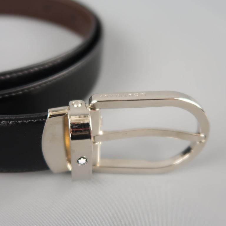 MONT BLANC dress belt features a dual tone brown and black reversible leather strap with a silver tone D shaped buckle. Minor wear on buckle. Made in Italy.   Good Pre-Owned Condition. Marked: (no size)   Length: 47 in. Width: 1 in. Fits: 38.5 -