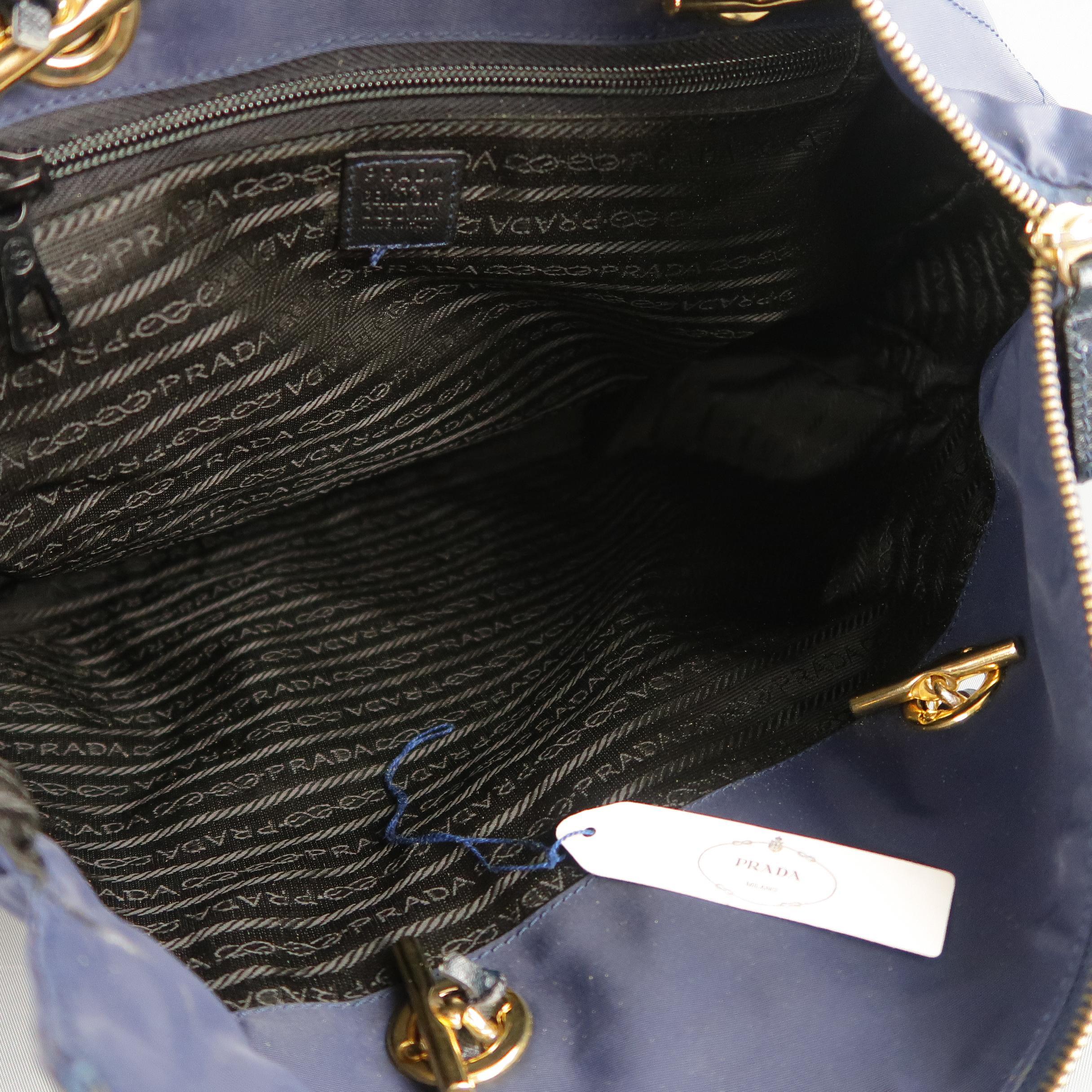114f16b7d02b Prada Vintage Navy Quilted Nylon Gold Chain Straps Shoulder Bag at 1stdibs