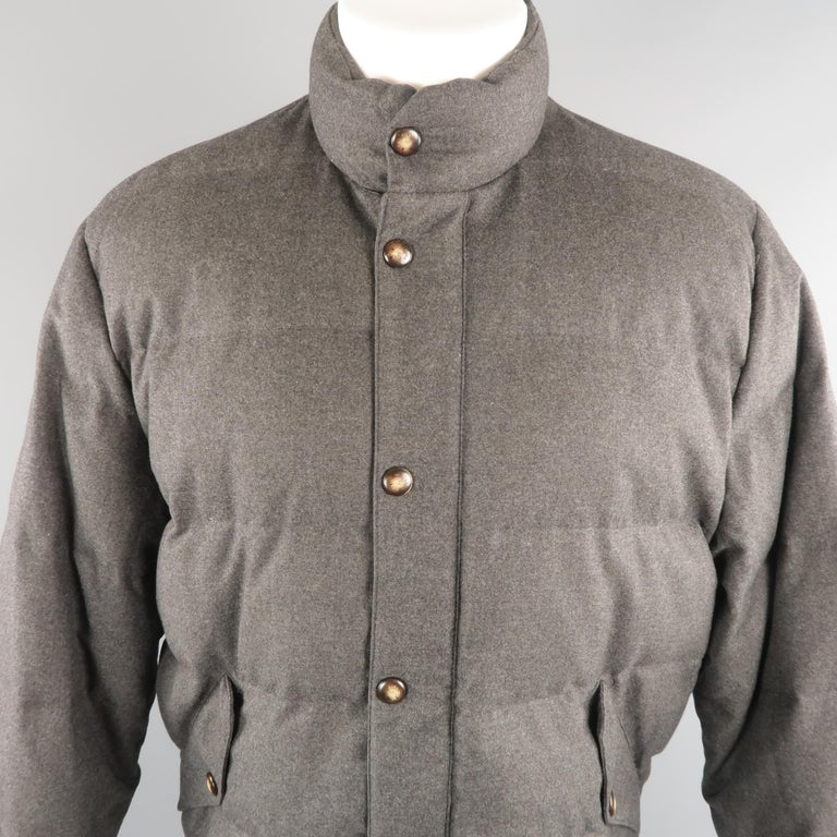 LORO PIANA puffer quilted  jacket come in charcoal tone in wool material, with flap pockets and adjusters on the cuffs. Made in Italy.   Excellent Pre-Owned Condition. Marked: M   Measurements:   Shoulder: 20 in. Chest: 100 in. Sleeve: 25