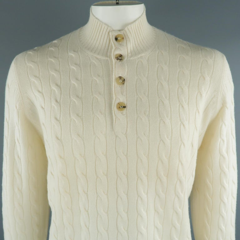 BRUNELLO CUCINELLI henley sweater come in 100% cashmere in a cream tone, cable knit, with ribbed cuffs and waistband. Made in Italy.   New with Tags. Marked: 54 IT   Measurements:   Shoulder: 17 in. Chest: 46 in. Sleeve: 26.5  in. Length: 28  in.