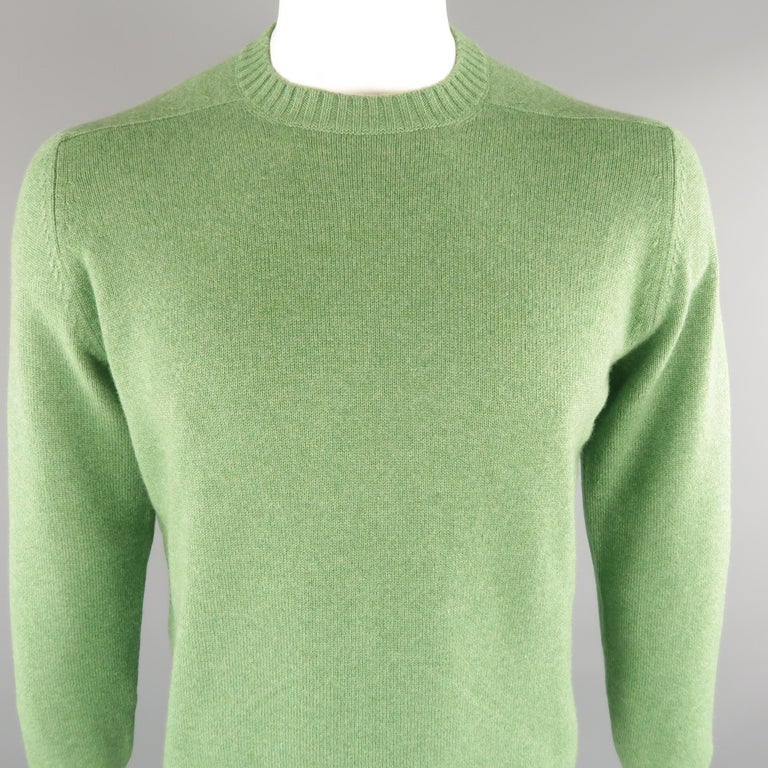 BRUNELLO CUCINELLI sweater comes in 100% cashmere in a green tone, knited, with a crewneck, ribbed cuff and waistband and suede elbow patches. Made in Italy.   Excellent Condition. Marked: 52 IT   Measurements:   Shoulder: 17.5 in. Chest: 46
