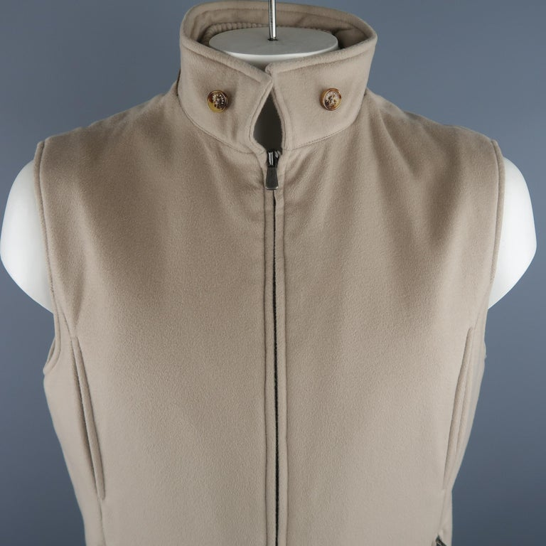 LORO PIANA vest comes in oatmeal solid cashmere material, suede trim and buttons on the collar, zip up, slit and zip pockets. Made in Italy.   Excellent Pre-Owned Condition. Marked: XL  IT   Measurements:   Shoulder: 18 in. Chest: 48 in. Length: