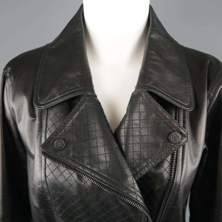 CHANEL biker jacket comes in smooth black leather with a classic collar, double breasted diagonal zip front, quilted leather panels, CC patch sleeve, and black zippers with CC emblem pulls. Minor Alteration / Tailored waist by Chanel. Measurements