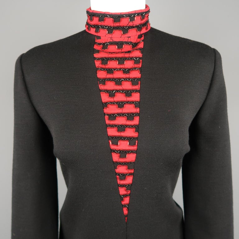 Vintage 1980's BOB MACKIE dress comes in black jersey knit with a shift silhouette, red beaded stand up collar with V panel and layered sleeves with red cuffs. Made in USA.   Good Pre-Owned Condition. Marked: (no size)   Measurements:   Shoulder: 16