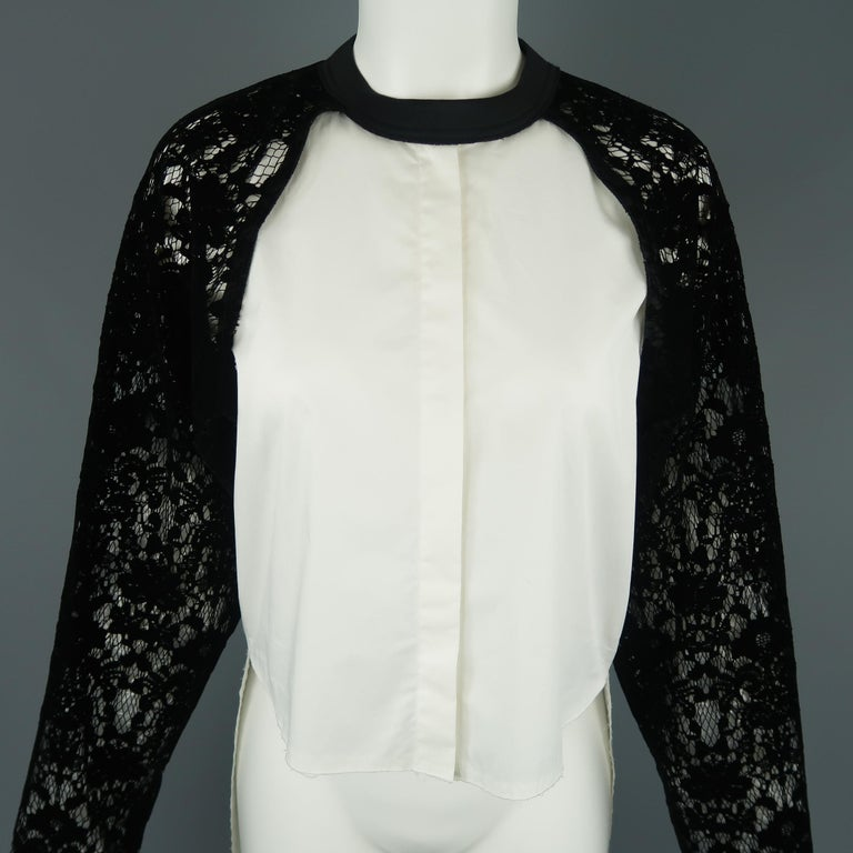 DKNY top features a white sleeveless shirt with raw edge high-low hem and black laser cut velvet lace raglan sleeve crewneck overlay.   New with Tags. Marked: S   Measurements:   Shoulder: 16 in. Bust: 38 in. Sleeve: 24 in. Length: 18 - 33 in.