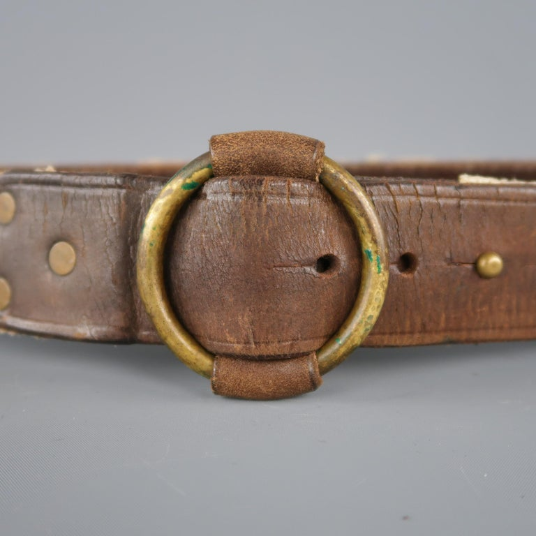 RRL by RALPH LAUREN belt features a dual tone in brown leather and beige rope materials, with a anchor print and an antiqued gold tone aged metal circular buckle . Retail price: 350.00.    Excellent Pre-Owned Condition. Marked 10/100.   Length: 45
