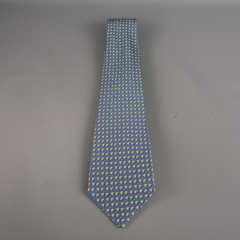 SALVATORE FERRAGAMO  tie come in blue and green silk  with an all over strawberry print. Made in Italy.   Excellent Pre-Owned Condition.   Width: 4 in.
