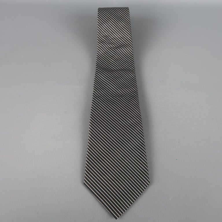 DIOR HOMME tie come in black and silver diagonal stripes in silk material. Made in Italy.   Excellent Pre-Owned Condition.   Width: 3.5 in.