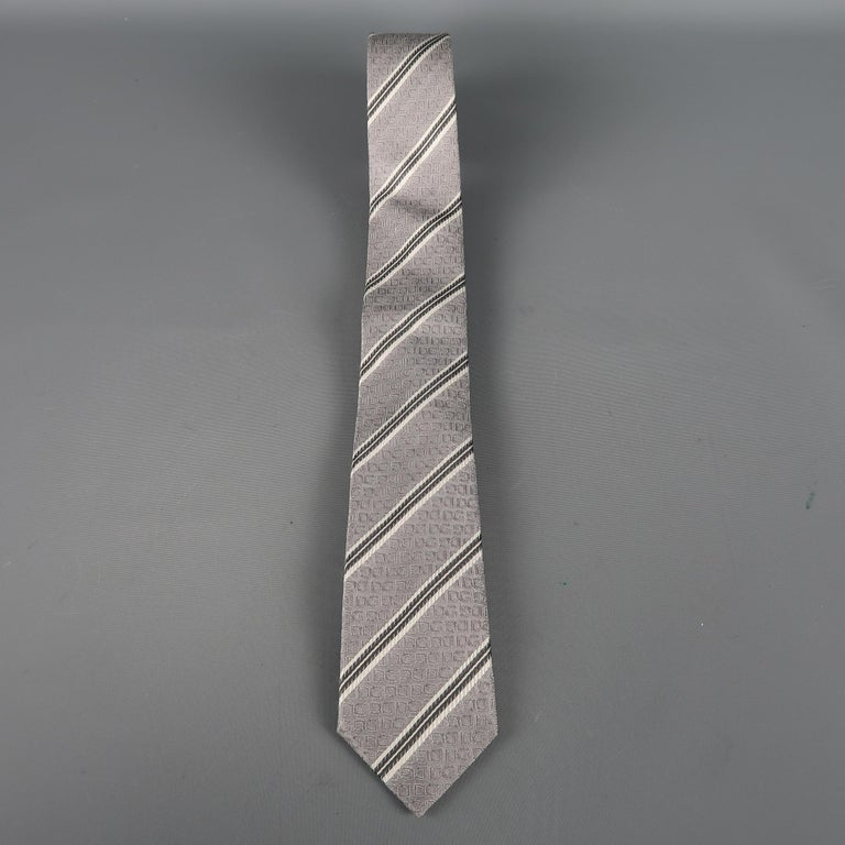 DOLCE & GABBANA skinny tie come in silver silk  with all over woven