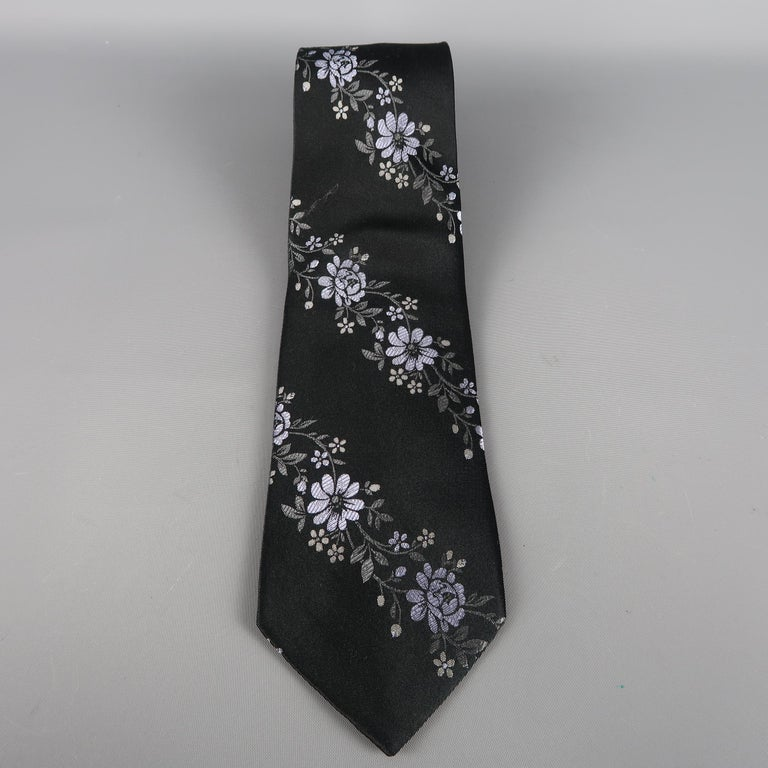 VALENTINO  tie come in black silk with all over woven lavender flowers. Made in Italy.   Excellent Pre-Owned Condition.   Width: 3.5 in.