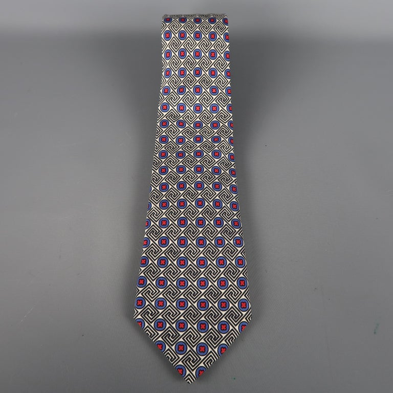 KITON  tie come in white, blue and  black silk  with an all over red crosses print. Made in Italy.   Excellent Pre-Owned Condition.   Width: 3.5 in.