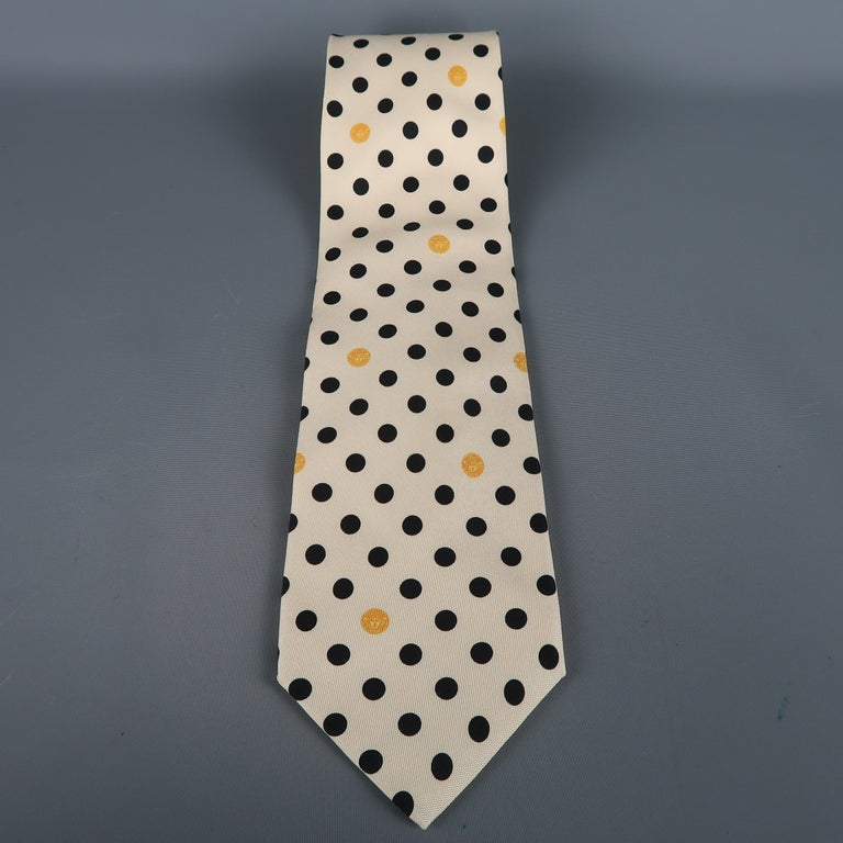 GIANNI VERSACE  tie come in beige silk with an all over polka dots print. Made in Italy.   Excellent Pre-Owned Condition.   Width: 4 in.