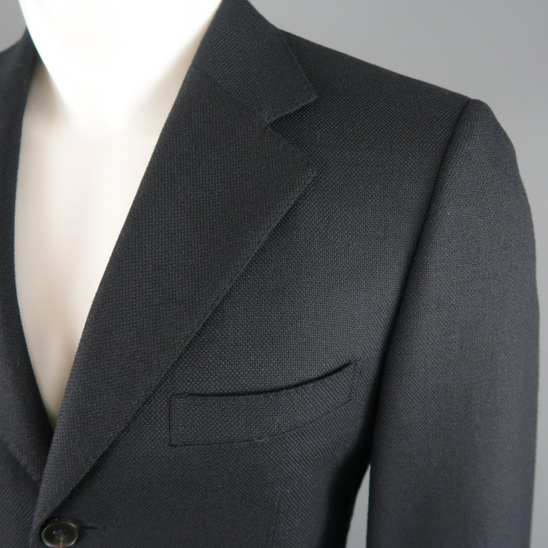 GUCCI sport coat comes in navy blue woven wool mohair with a notch lapel, notch three button closure, and single vented back. Made in Italy.   Excellent Pre-Owned Condition. Marked: IT 46   Measurements:   Shoulder: 17 in. Chest: 40 in. Sleeve: 25