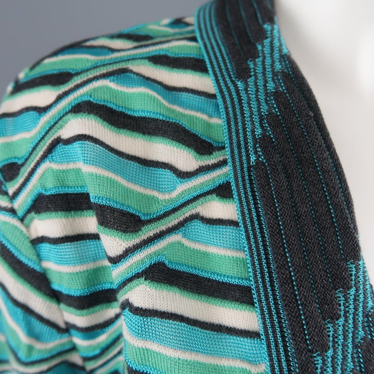 M MISSONI cardigan comes in an aqua blue and green textured print knit with an open front, three quarter sleeves, and brown textured trim.   New with Tags. Marked: IT 46   Measurements:   Shoulder: 17 in. Bust: 38 in. Sleeve: 20 in. Length: 26 in.
