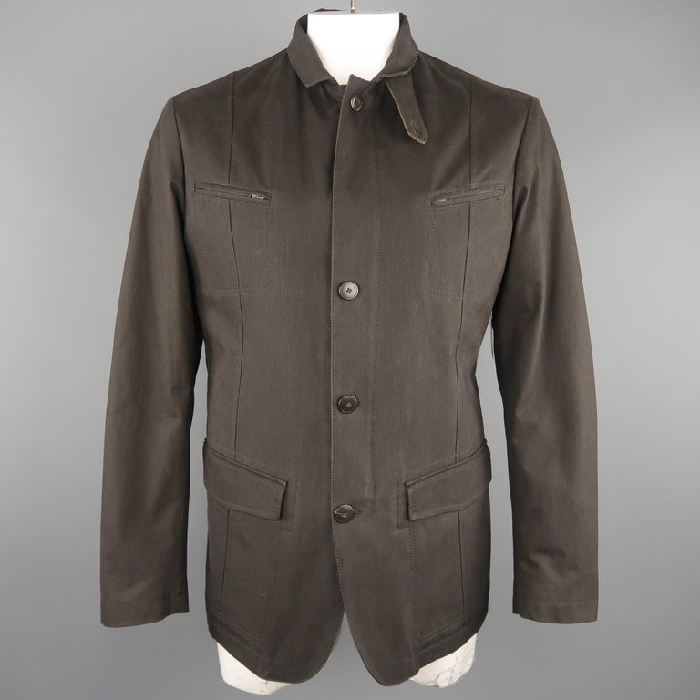 LORO PIANA military style jacket comes in a dark taupe cotton blend twill with a zip closure, button placket, zip chest pockets, patch flap military pockets, optional notch lapel, and detachable padded liner. Made in Italy.   New without Tags.