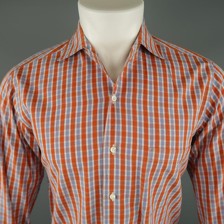 LORO PIANA long sleeve shirt comes in orange and white tones in plaid cotton material, with a spread collar, front pocket and button up.   Excellent Pre-Owned Condition. Marked: S   Measurements:   Shoulder: 15.5 in. Chest: 42 in. Sleeve: 26