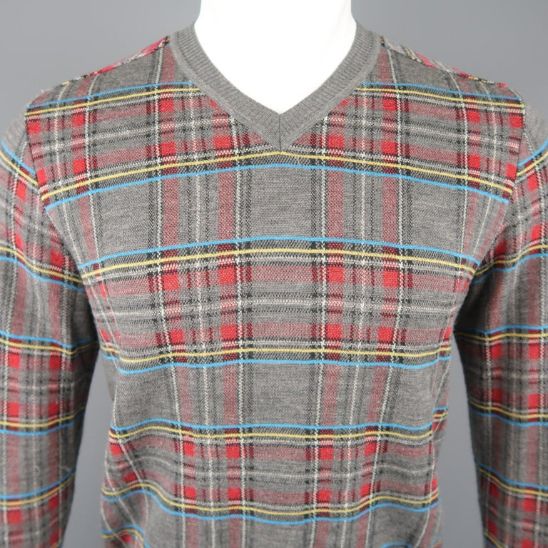 JUNYA WATANABE COMME des GARCONS MAN pullover sweater comes in grey wool blend knit with all over primary color plaid pattern, v neck, reverse back panel, flannel back panel, and brown suede elbow pads. Made in Japan.   Excellent Pre-Owned