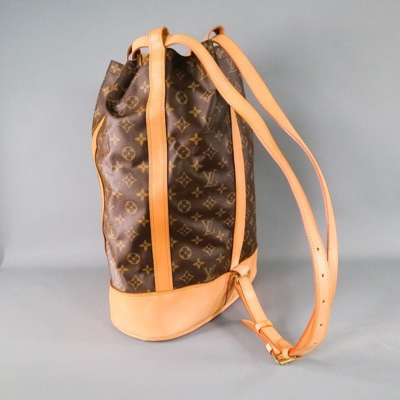 9aa0330a0ee1 RANDONNEE GM sack bag by LOUIS VUITTON. Beautiful pebbled brown leather in  signature Louis monogram