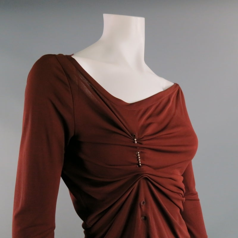 JEAN PAUL GAUTIER brings his un-conventional flare to every design including this piece.  Long sleeve reddish brown dress top in a fine rayon/jersey blend.  Metal ball chain loops through shirt's eyelets and hangs at bottom in a cluster of metal