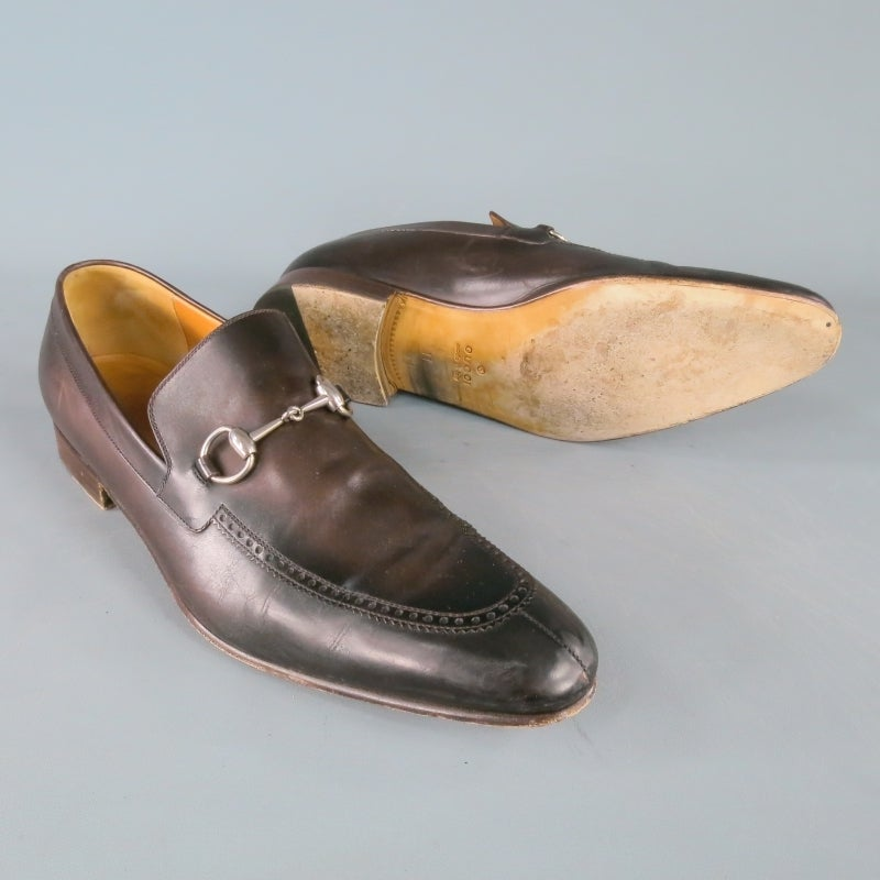 f8a7f69d3 Gucci Slip On Loafers consists of leather material in a brown color tone.  Designed with